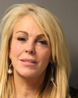 Dina Lohan was arrested Sept. 12, 2013, in New York on suspicion of driving while intoxicated after cops pulled her over for driving 77 mph in a 55 zone. She blew a 0.20 on a breath test, cops said, more than twice New York's legal limit of 0.08.