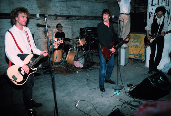 The Replacements (L-R) Tommy Stinson-Bass, Steve Foley-Drums,Paul Westerberg-Vocals/Guitar, Slim Dunlap-Guitar perform for Warner Bros Records staff and friends in the basement of Metro Studios in Minneapolis, Minnesota.