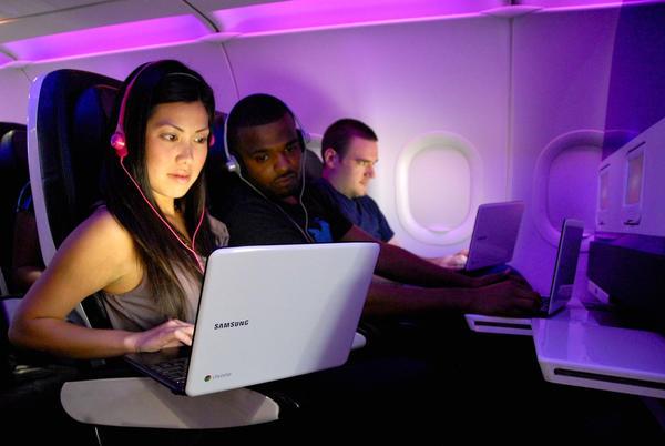 Passengers on a Virgin America flight use Gogo Wi-Fi.