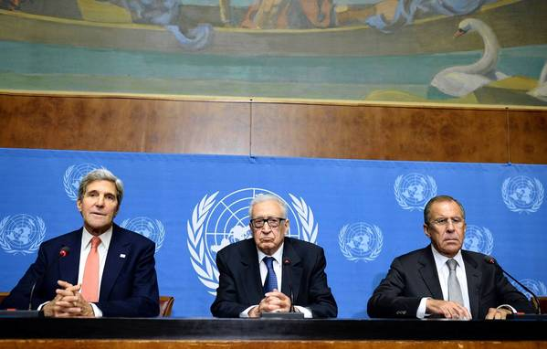 Secretary of State John Kerry (from left) speaks Friday, sitting next to United Nations-Arab League special envoy for Syria Lakhdar Brahimi and Russian Foreign minister Sergey Lavrov, during a press conference after their high-stakes talks on Syria's chemical weapons at the UN headquarters in Geneva.