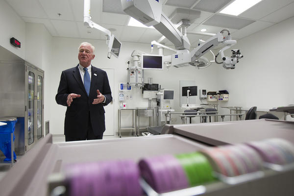 Dr. Roger Steinert, the director of the Gavin Herbert Eye Institute, gives a tour of one of two operating rooms during the grand opening of the facility on Wednesday, September 11.