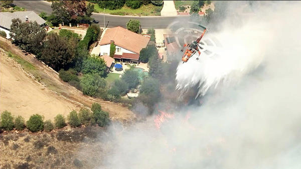 A brush fire broke out in a La Verne neighborhood Friday afternoon. It spread to 40 acres, but is expected to be fully contained by late Friday afternoon or evening.