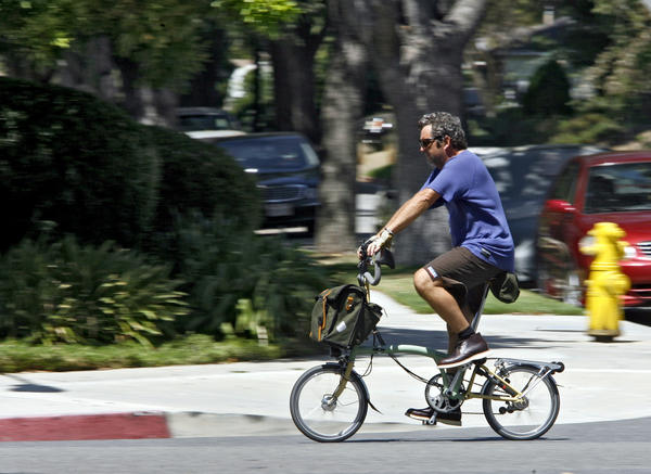 A bicyclist pedals down Sonara St. near Victory Blvd. in Glendale on Wednesday, August 29, 2012.
