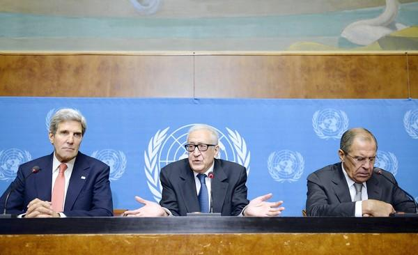 From left, Secretary of State John F. Kerry, U.N. special envoy to Syria Lakhdar Brahimi and Russian Foreign Minister Sergei Lavrov hold a news conference in Geneva on the effort to restart long-stalled talks to resolve Syria's civil war.