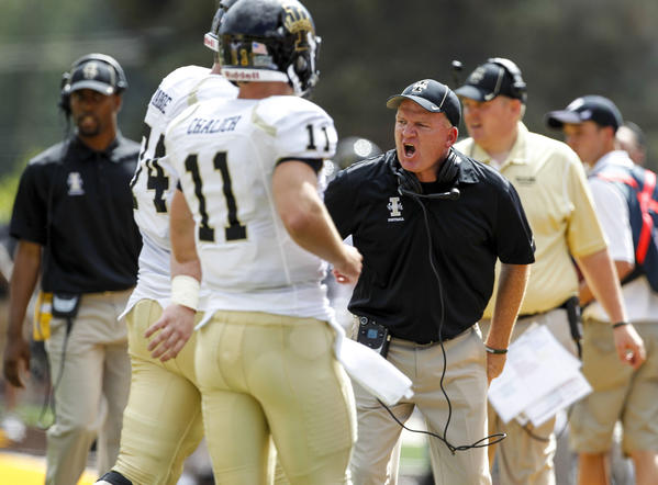 Idaho coach Paul Petrino reacts during the first quarter against Wyoming.