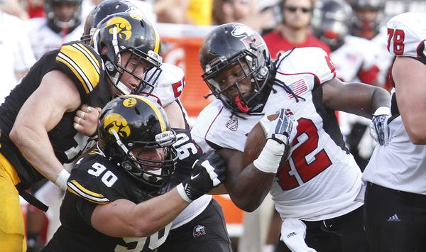 Northern Illinois running back Cameron Stingily rushes down the field during the third quarter against Iowa.