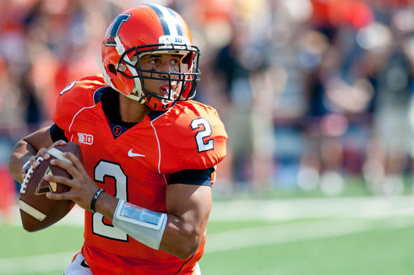 Illinois quarterback Nathan Scheelhaase looks for an open receiver during the first quarter against Cincinnati.