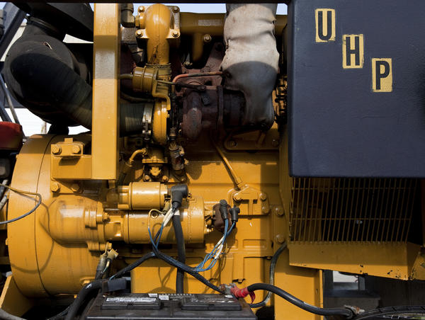 UHP Projects, Inc. operates and rents a water pump that works as a part of a system that blasts the surface of ships in a sealed environment without creating dust.