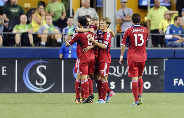 The Fire celebrate after forward Mike Magee scored a goal against the Sounders.