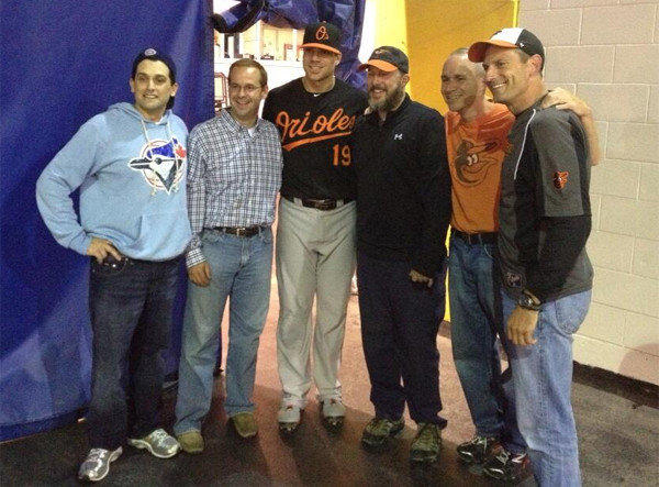 Steve Houff of Ellicott City (left of Chris Davis, in plaid) bought Davis' 50th home run ball from a Blue Jays fan so he could present it to the Orioles slugger.