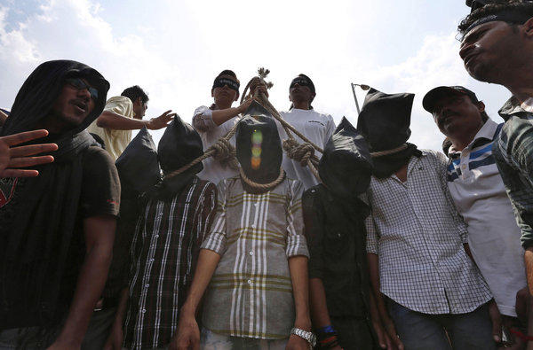 Indian protesters stage a mock hanging scene to demand what they see as the proper penalty for four men accused in the rape and murder of a young woman in December.