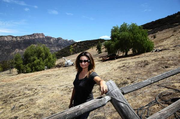 Irena Hauser stands on her Malibu property where the tigers' home would be built