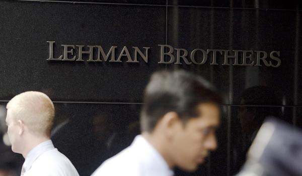 People pass the Lehman Brothers headquarters in New York in this September 15, 2008.