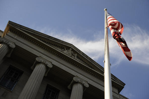 A US flag flies outside the U.S. Department of Justice headquarters building in Washington, July 14, 2009.