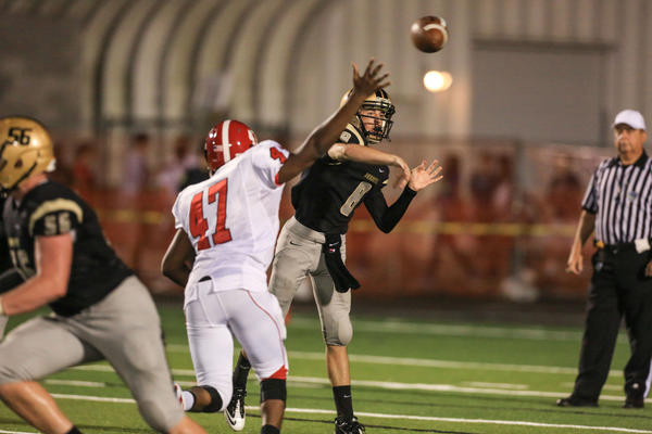 Bishop Moore quarterback Colin Hartmann (8) gets off a pass as he is pressured by Edgewater's David Beachum (47) during second quarter action of a high school football game against Edgewater in Orlando, Fla. on Friday, September 13, 2013. (Joshua C. CrueyOrlando Sentinel)
