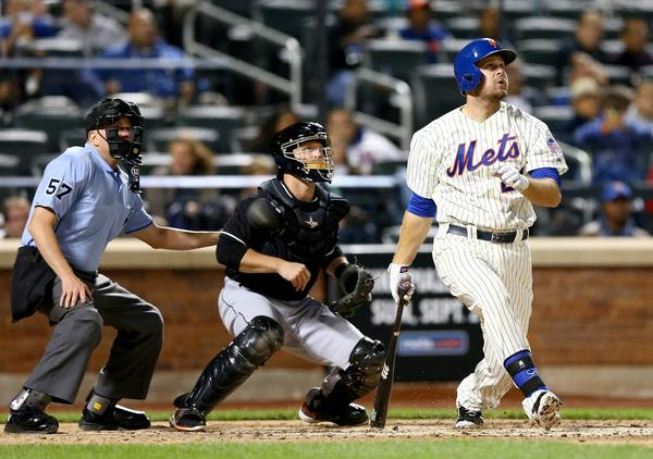 NEW YORK, NY - SEPTEMBER 13: Lucas Duda #21 of the New York Mets hits a three run homer as Koyie Hill #46 of the Miami Marlins catches on August 13, 2013 at Citi Field in the Flushing neighborhood of the Queens borough of New York City. (Photo by Elsa/Getty Images) ORG XMIT: 163495516