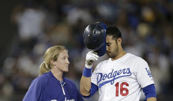 Dodgers center fielder Andre Ethier speaks with assistant athletic trainer Nancy Patterson after suffering a left ankle injury during the eighth inning of the Dodgers' 4-2 loss to the San Francisco Giants.