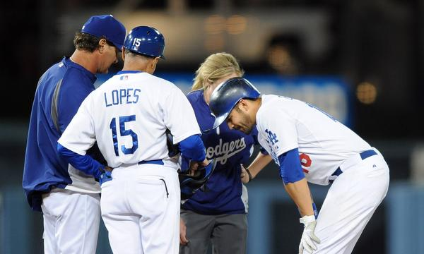 Dodgers center fielder Andre Ethier, right, speaks with Dodgers Manager Don Mattingly, far left, first base coach Davey Lopes, left center, and assistant trainer Nancy Patterson after suffering an ankle injury during Friday's 4-2 loss to the San Francisco Giants.