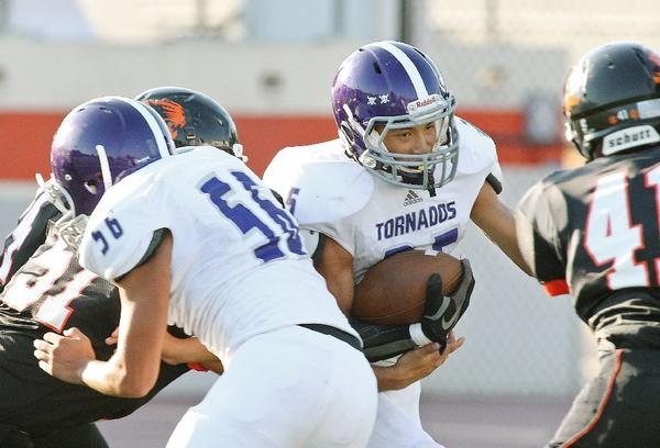 Hoover's Earl Rivera, center, attempts to cut up field between two South Pasadena High football players.