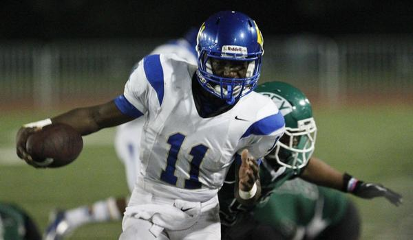 Crenshaw quarterback Ajene Harris played an instrumental role in the Cougars' 23-17 double-overtime victory over Loyola on Friday night.