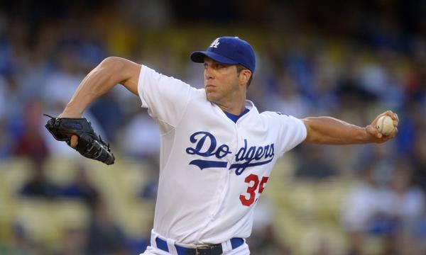 Dodgers pitcher Chris Capuano is still hampered by a groin injury suffered last week.