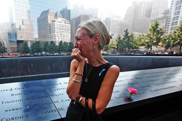 Carrie Bergonia of Pennsylvania looks over the name of her fiance, firefighter Joseph Ogren, at the 9/11 Memorial in New York on Wednesday.
