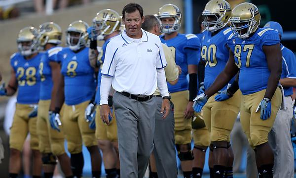 UCLA Coach Jim Mora watches his players warm up before the Bruins' season opener against Nevada last month.