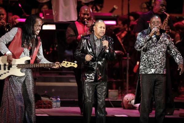 From left, Verdine White, Ralph Johnson and Philip Bailey of Earth, Wind and Fire perform with the Hollywood Bowl Orchestra at the Hollywood Bowl.