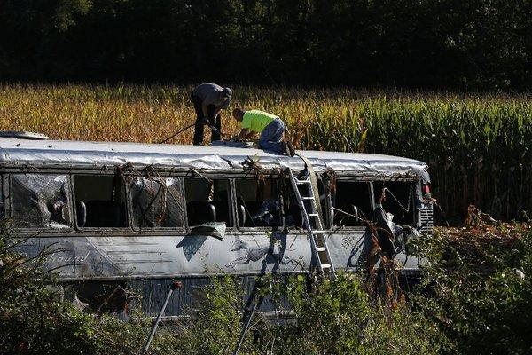 A crew works to remove an overturned Greyhound bus from a field after an early-morning crash along interstate 75 in Liberty Township, Ohio. At least 35 people were injured.