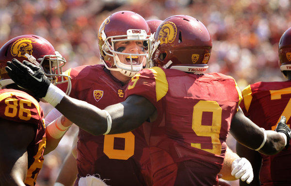 USC quarterback Cody Kessler celebrates with receiver Marqise Lee after connecting on an 80-yard touchdown against Boston College in the second quarter at the Coliseum.