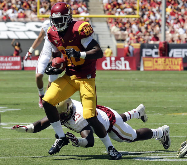USC wide receiver De'Von Flournoy breaks away from Boston College linebacker Josh Keyes in the first half of their game Saturday at the Coliseum.