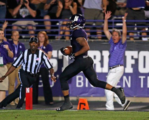Tony Jones scores a touchdown after a catch against Syracuse at Ryan Field.