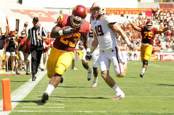USC running back Tre Madden beats Boston College's Sean Sylvia to the end zone in the third quarter at the Coliseum.