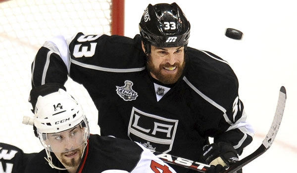 Kings defenseman Willie Mitchell, shown during the 2012 Stanley Cup final, played in Saturday's scrimmage at El Segundo after missing all of last year because of an injured knee.