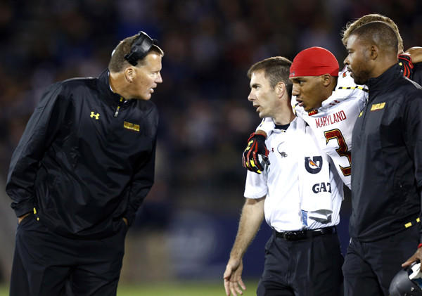 Maryland coach Randy Edsall speaks to trainers after Terps wide receiver Nigel King was injured against UConn.