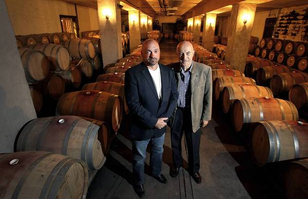 Wine maker Matthew Meyer and Williamsburg Winery founder Patrick Duffeler stand in the wine cellar on the winery that will be celebrating 25 years in business. The land the winery sits on was purchased in 1983 and by 1988 they had produced their first wines.
