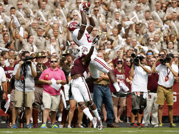 Alabama's Kevin Norwood makes a touchdown catch over Texas A&M's De'Vante Harris during Saturday's game in College Station, Texas.