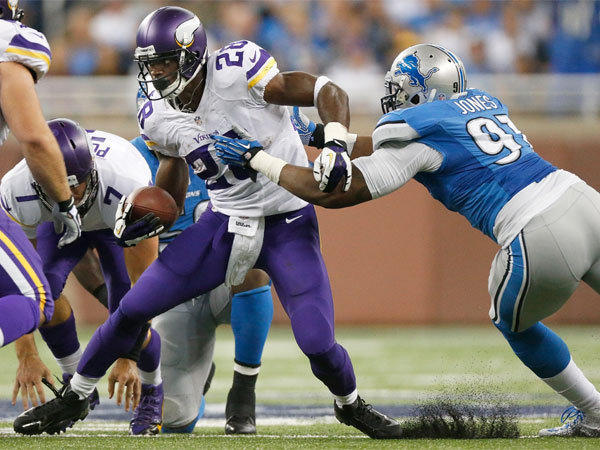 Minnesota's Adrian Peterson, shown running against Detroit's Jason Jones last week, came off of reconstructive knee surgery to finish nine yards short of the single-season rushing record in 2012.