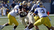 QB Keenan Reynolds leads Navy over Delaware, 51-7