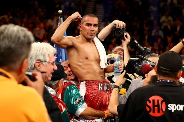 Carlos Molina celebrates his split decision victory against Ishe Smith in their IBF junior middleweight title fight at the MGM Grand Garden Arena.