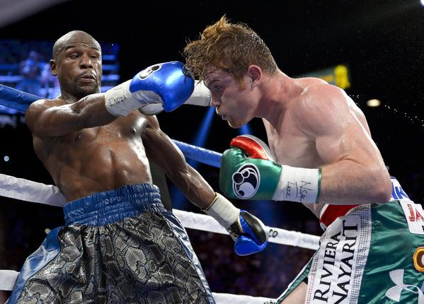 "Floyd Mayweather Jr. put on a boxing clinic against Saul ""Canelo"" Alvarez, claiming the World Boxing Council and World Boxing Assn. light-middleweight belts in the process."