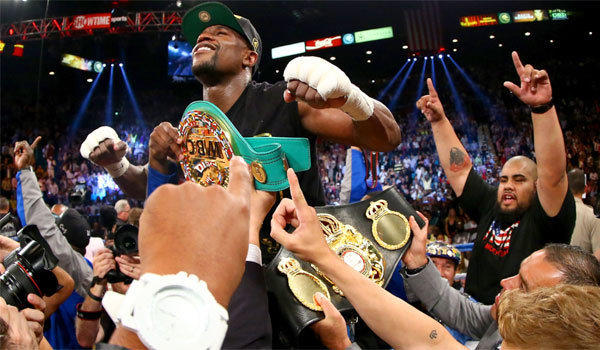 "Floyd Mayweather Jr. celebrates his majority decision victory over Saul ""Canelo"" Alvarez in their WBC/WBA 154-pound title fight Saturday night at the MGM Grand Garden Arena in Las Vegas."