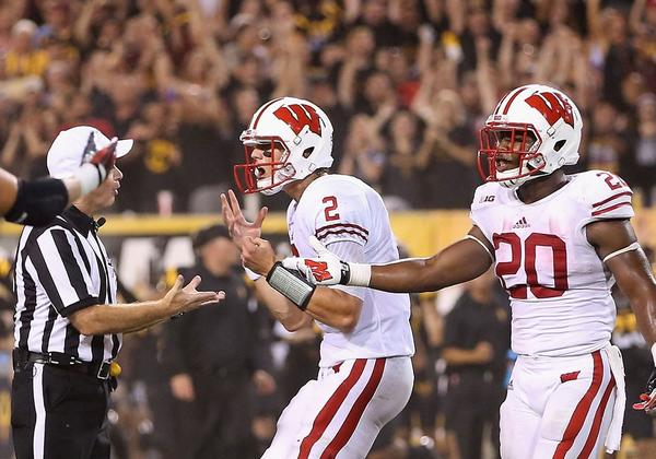 Quarterback Joel Stave (2) and running back James White (20) of the Wisconsin Badgers argue with the referee following a 32-30 defeat to the Arizona State Sun Devils.