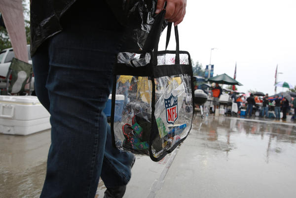 Amy Dannowitz of Urbana carries a see-through bag in order to enter Soldier Field on Sunday.