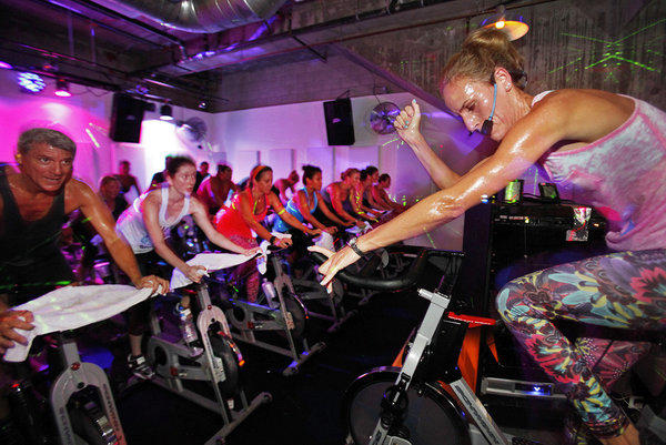 Instructor Melissa Lau leads a class at the Sweat Shoppe in North Hollywood.