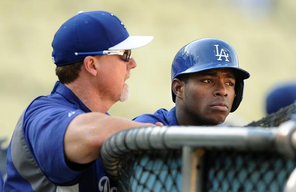 Dodgers hitting coach Mark McGwire, left, speaks with right fielder Yasiel Puig during batting practice before Thursday's game against the San Francisco Giants.