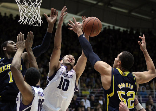 Michigan's Jordan Morgan (52) and Northwestern's Mike Turner (10) stretch for the ball in the first period at Welsh-Ryan Arena Thursday, Jan. 3, 2013.