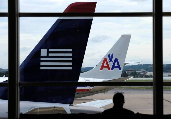 American Airlines and US Airways are unlikely to raise fares because it would give the U.S. another reason to oppose their merger.