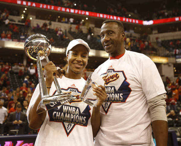 Tamika Catchings and her father, Harvey, after she won the MVP Trophy while the Fever beat Minnesota for last season's WNBA title.