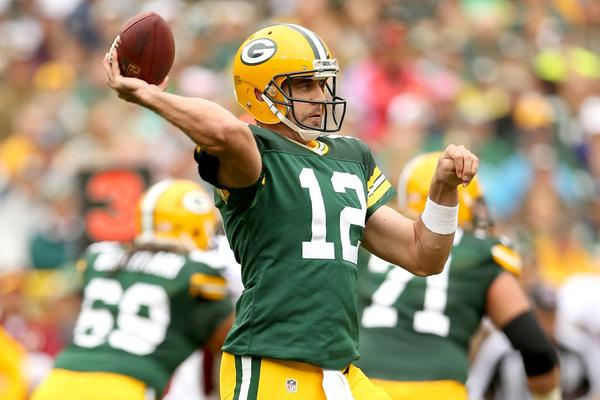 Aaron Rodgers throws a pass during Sunday's rout of Washington.